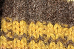 Knitted texture, yellow, brown wool, crafts Stock Images