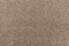 Knitted textured a herringbone of brown color Stock Photo