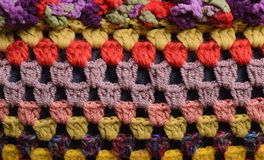 Knitted things. Fragment of knitted cushions with large viscous Stock Photos