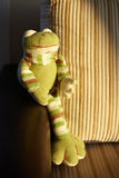 Knitted toy frog Stock Photos