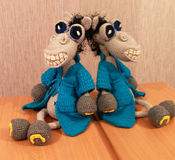 Knitted toy merry Horse Demyan in the reflection of a mirror Stock Image