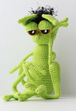 Knitted toy mymra in sorrow Stock Photography