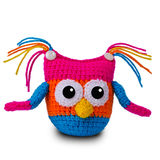 Knitted toy owl. Knitted multicolored toy owl on a white background Royalty Free Stock Photo