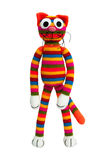 Knitted toy - striped cat. Royalty Free Stock Images