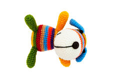 Knitted toy - striped lying dog. Stock Image