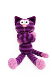 Knitted toy - striped sitting cat. Stock Photo