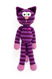 Knitted toy - striped sitting cat. Royalty Free Stock Photo
