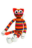 Knitted toy - striped sitting cat. Stock Photography