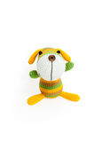 Knitted toy - striped sitting dog. Royalty Free Stock Photo