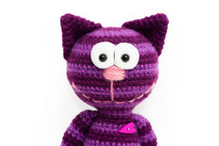 Knitted toy - striped smiling cat. Royalty Free Stock Photos