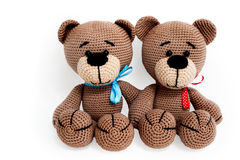 Knitted toy - two striped sitting bears. Royalty Free Stock Images