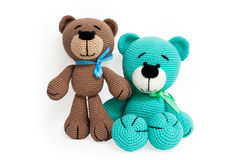 Knitted toy - two striped sitting bears. Stock Photos