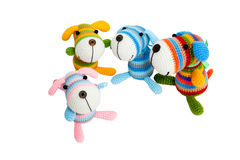 Knitted toys – four striped dogs. Knitted toys – four striped dogs on white background, isolated stock photos