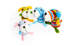 Knitted toys – four striped dogs. Knitted toys – four striped dogs on white background, with shadow royalty free stock image