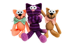 Knitted toys - striped embraced cats. Stock Photos