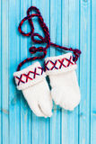 Knitted Traditional lovvika mittens. A pair of Swedish mittens on tourquise wooden stock images