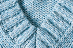 Knitted v-neck detail. Knitted v-neck close up light blue and white mixed Royalty Free Stock Image