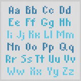 Knitted vector alphabet, blue small sans serif letters. Royalty Free Stock Photography