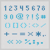Knitted vector alphabet, blue small sans serif numbers and punctuation. Stock Photography