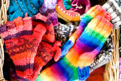 Knitted wares in a wicker basket Stock Images