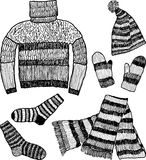 Knitted warm clothes Royalty Free Stock Photos