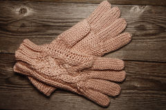 Knitted warm gloves on old rustic Wooden texture Royalty Free Stock Image
