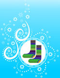 Knitted warm socks on a blue winter background with snowflakes Stock Photo