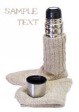 Knitted warm socks and a thermos isolated Royalty Free Stock Photography