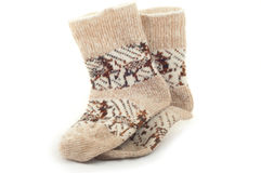 Knitted warm winter socks with reindeer  woolen yarn Royalty Free Stock Photography