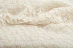 Knitted white scarf handmade Stock Photo