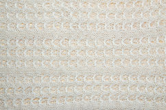 Knitted white woolen fabric Royalty Free Stock Photos