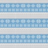 Knitted winter background. Knitted winter blue and gray background with snowflakes Stock Photo