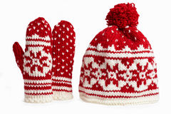 Knitted winter cap and mittens. on white. Winter cap and mittens knitted with jackard and heart motifs. on white Stock Photos