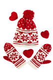 Knitted winter cap and mittens. on white. Winter cap and mittens knitted with jackard and heart motifs. on white Stock Images