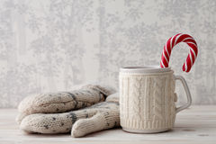 Knitted winter cup with candy cane Royalty Free Stock Images
