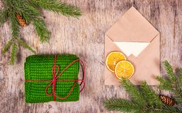Knitted winter gift and Christmas decorations. Packing gift and preparing for the holiday. stock images