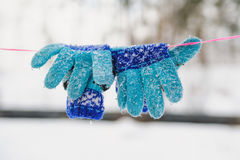 Knitted winter gloves of a rope Royalty Free Stock Photography