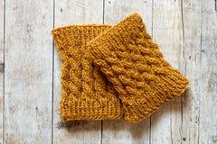 Knitted wood legwarmers Stock Photo