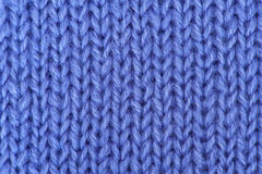 Knitted wool background. Knitted purple wool background pattern Royalty Free Stock Images