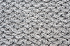 Knitted wool background. Knitted grey wool background pattern Stock Photo