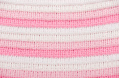 Knitted wool macro photo closeup pink and white color as background Stock Photography