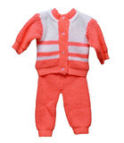 Knitted wool overalls for baby on white Royalty Free Stock Images