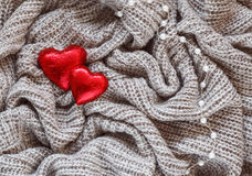 Knitted wool, red heart, pearl, valentine Stock Photos