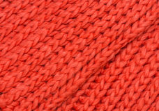 Knitted wool. Red knitted merino wool background stockinette stitch Royalty Free Stock Images