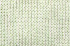 Knitted wool scarf fabric texture background. Seamless knitted green and white wool scarf background. Neutral winter fabric  texture Stock Photo