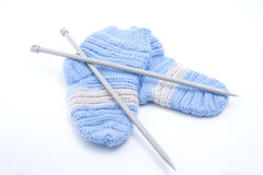 Knitted wool socks and knitting needles. Stock Image