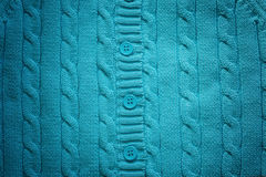 Knitted woolen background with buttons. Color of Royalty Free Stock Photo