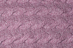 Knitted woolen background. Fabric texture Royalty Free Stock Photo