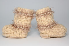 Knitted woolen bootees for young children. Warm knitted woolen bootees for young children Royalty Free Stock Photography