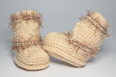 Knitted woolen bootees for young children. Warm knitted woolen bootees for young children Stock Photography